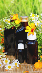 Homemade essential oils in dark glass bottles